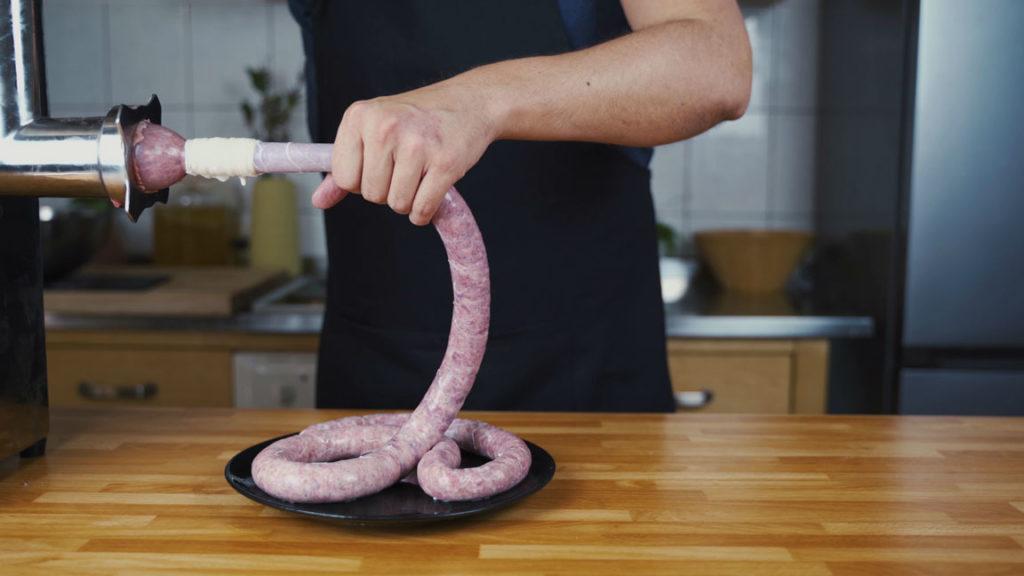 Bratwurst press the meat